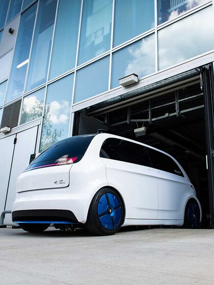 White city car developed by the German Aerospace Center. It's called an Urban Modular Vehicle.